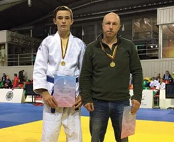 Aukso medalį iškovojęs E. Sobolevski su treneriu O.Čiursinu